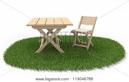 Folding Table And Chair On Green Grass