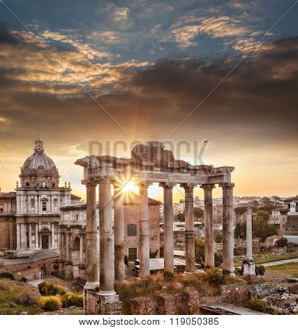 Famous Roman Ruins Against Sunrise In Rome, Italy