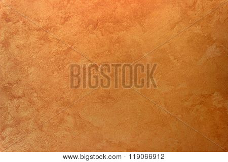 Wall texture orange gold  silk effect Paint background.