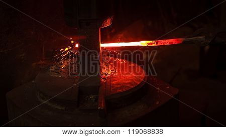 blacksmith bending hot iron on mill with sparks