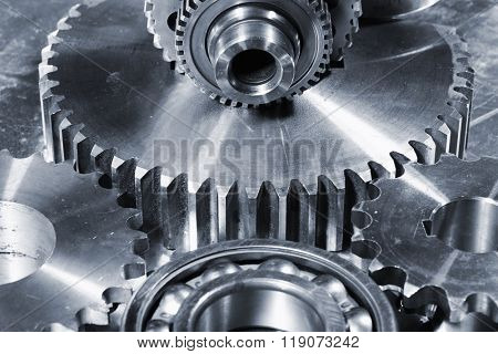 titanium and steel parts, ball-bearings, gears in a blue toning concept