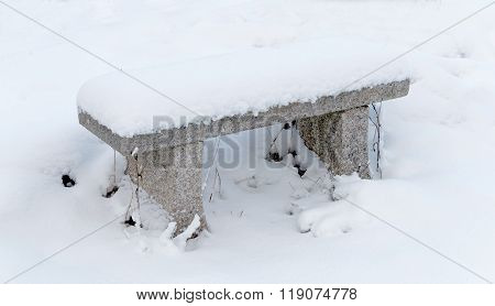 Stone Bench Covered With Snow