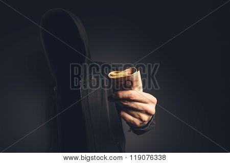 Unrecognizable Hooded Computer Hacker Offering Cash Money