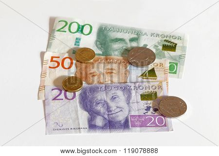 New layout 2015 of the swedish SEK 20 and SEK 200 bank note with the famous writer Astrid Lindgren song writer Evert Taube and director Ingmar Bergman. Also coins. Short depth of focus.