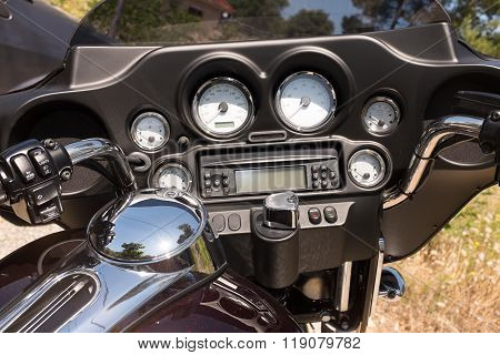 Motorcycle Handlebar Controls Including Speedometer And Tachometer