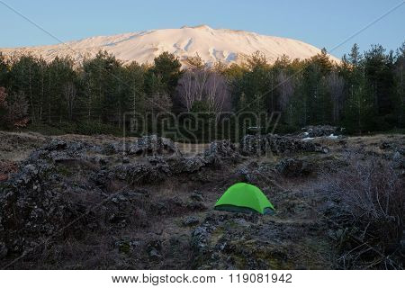 green tent under volcano Etna National Park, Sicily