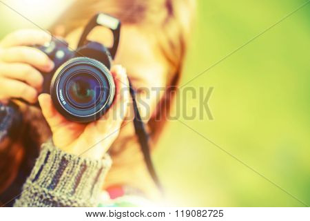 Photography Hobby. Girl with Modern Digital Interchangeable Lenses Photo Camera. poster