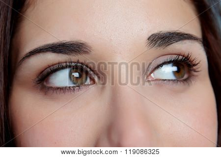 Young girl with brown eyes thinking while looking to the side