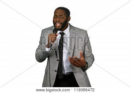 Afroamerican jazz singer. Darkskinned man is singing. Jazzman is performing. Vocal studio performance. poster