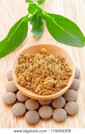 Herbal Powder In Wooden Spoon On Herb Tablet.