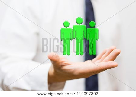 businessman is holding virtual wining team staffing and human resources concept