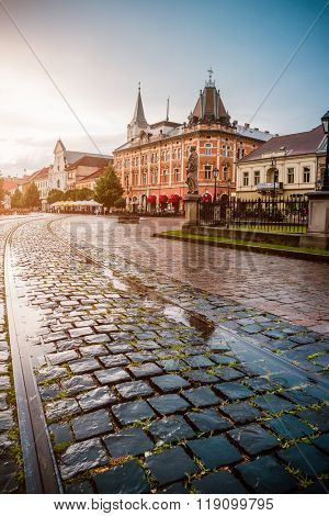 central square in Kosice with tram rails after rain poster