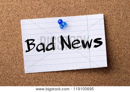 Bad News - Teared Note Paper Pinned On Bulletin Board