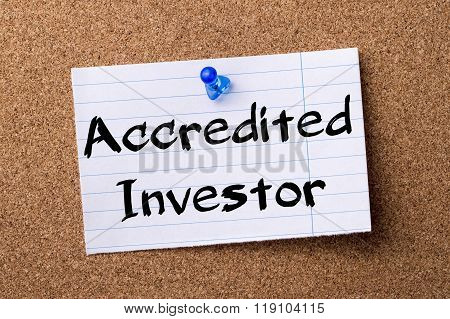 Accredited Investor - Teared Note Paper Pinned On Bulletin Board