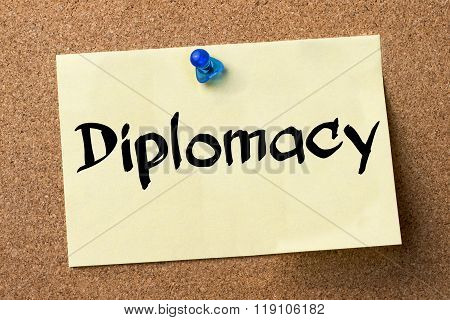 Diplomacy - Adhesive Label Pinned On Bulletin Board
