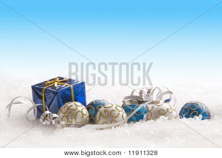 Christmas gift and ornaments in snow