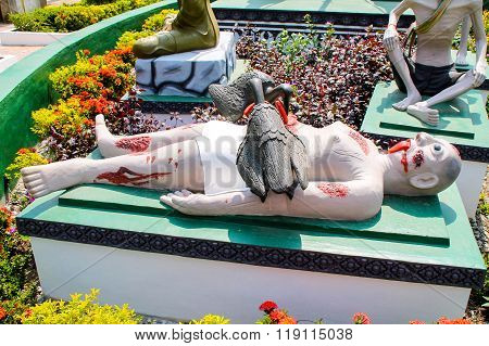 Scuplture Of A Man Eaten Alive From Vultures