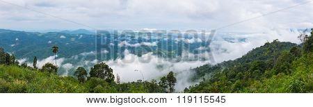 Panorama Of Landscape At National Park, Field Against Blue Sky And Clouds. The Fog Is Swinging Betwe