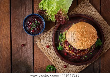 Hamburger With Juicy Turkey Burger With Cheese, Caramelized Onions And Cranberry Sauce. Top View