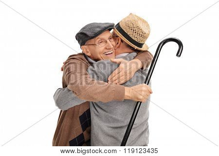 Studio shot of two old friends hugging each other isolated on white background