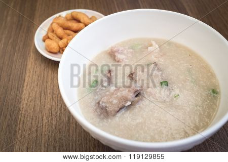 Pork Congee with  Crispy Thai deep-fried dough stick