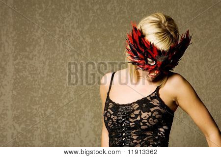 Beautiful blond girl with mask