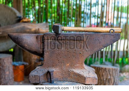 Heavy Hammer On The Anvil In The Forge Close Up