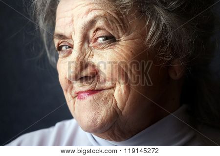 Cunning and smiling granny face