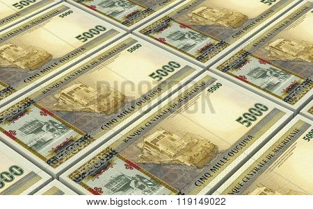 Mauritanian ouguiya bills stacks background. Computer generated 3D photo rendering