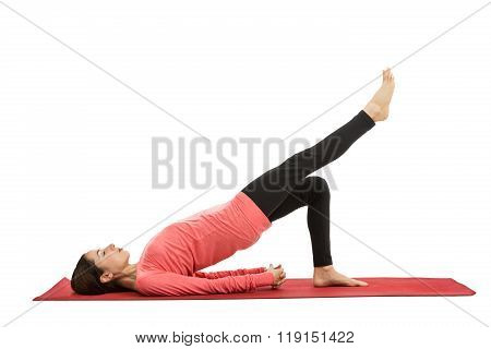 Caucasian woman doing bridge pose with leg extension during fitness. Isolated on white background. poster
