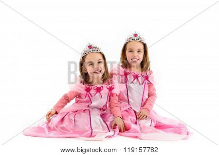 Little Twin Girls Are Dressed As Princess In Pink