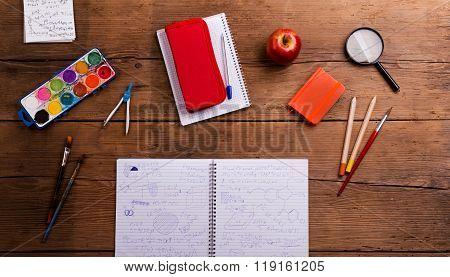 Various school and art supplies, wooden desk, flat lay