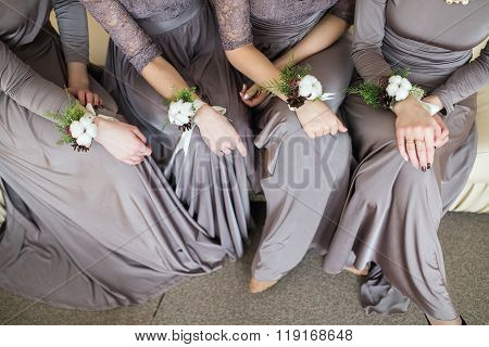 Bridesmaids With Wedding Bouquet Of Flowers