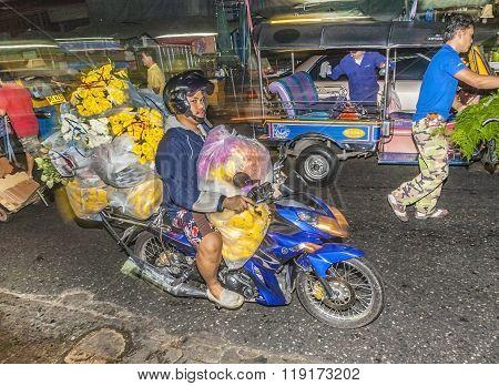 People Transport Flowers At Pak Khlong Thalat Market