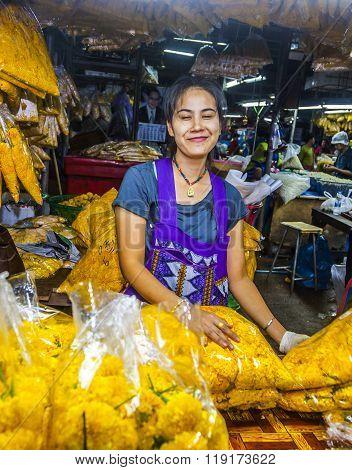 Women Sells Fresh Flowers At The Flower Market