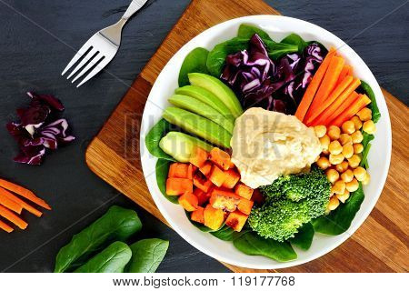 Healthy bowl with super-foods on slate background