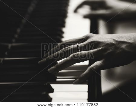 Close Up Of The Hands Of A Young Woman Playing Piano, Selective Focus And Small Depth Of Field