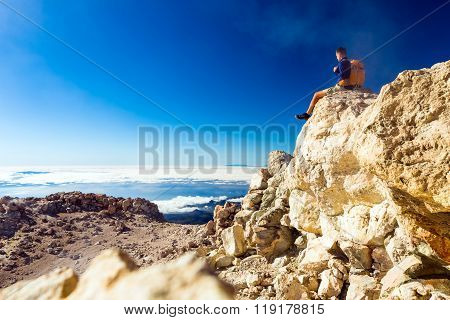 Hiking Man Or Trail Runner Looking At View In Mountains