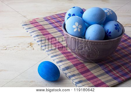 Blue Easter Eggs In A Purple Bowl