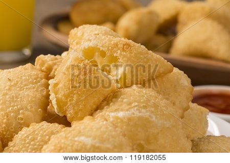Pastel, A Brazilian Snack, With A Bar In The Background. Cheese Pastry.