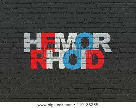 Medicine concept: Hemorrhoid on wall background