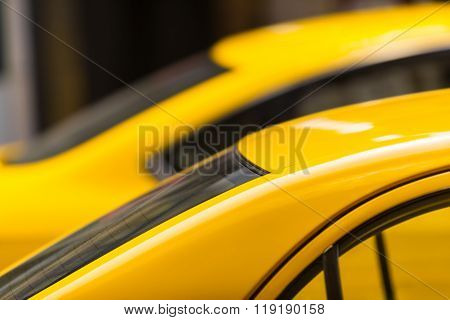 Detail of waiting in a line taxi cars at the city look like a yellow flash