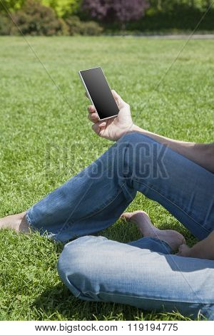 Blank Phone In Hand Of Barefoot Woman