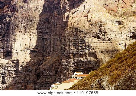 Comfortable cottages on a background huge rocks of Los Gigantos