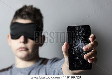 Sad Teen With Sleep Mask Is Worried Because Of Breakage Glass Of Smart Phone In Front Of Grey Backgr