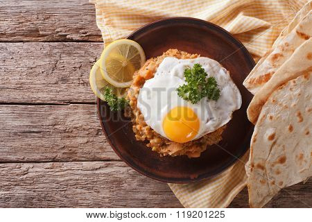 Egyptian Breakfast: Ful Medames With A Fried Egg. Horizontal Top View
