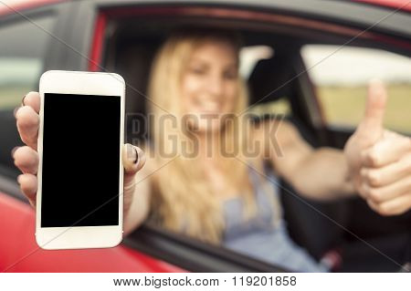 Happy blonde woman showing smartphone.