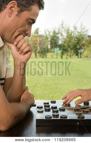 Man playing checkers