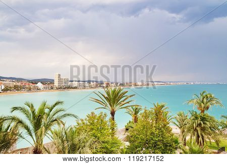 View Over The Palm Trees And Coastline Of Peniscola, Spain