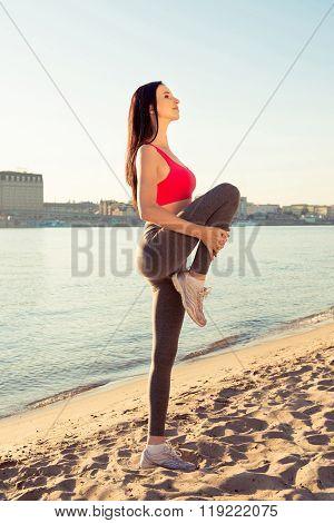 Pretty Sexy Slim Girl Stretching Her Legs Near The Sea